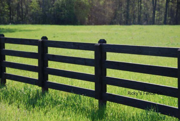 black wood farm fence.