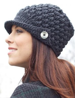 Women's Peak Hat, found here: http://com.yarnspirations.pattern-pdfs.s3.amazonaws.com/WEB-P-CAN-WomensPeakedHat-ENG.pdf