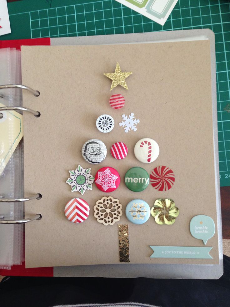 Pins and other embellishments arranged in a tree shape.  December Daily by Paper & Confetti