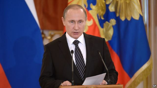 Russian President Vladimir Putin addresses members if the military in Moscow's Kremlin, March 17, 2016.