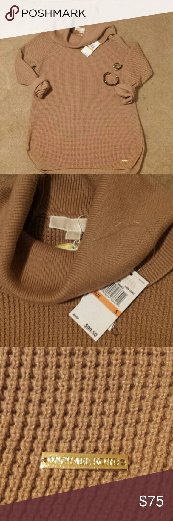 Michael Kor camel cowl neck sweater. size small Beautiful camel colored waffle weave towel neck sweater by Michael Kor   Rounded hem Metal logo plate on the lower hemline  Beautiful and soft cotton blend material   Perfect with dress pants or your favorite jeans very versatile and classically styled  Retail 9950   ****************** no low-ball offers will be acknowledged  No trades  NO bundles over 5 lbs  ******************  Happy Poshing!! Michael Kors Sweaters Cowl & Turtlenecks