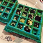 Blue Corn Waffles recipe. You won't feel blue as you eat these faintly blue-tinted waffles.  The color comes from blue cornmeal - the same ingredient used to make festive tortillas. NOTE: your waffles will not be as blue as the waffles in the picture, unless you add food coloring to the batter.