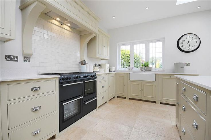 Neptune Chichester kitchen in Limestone with double door sink unit and large range cooker
