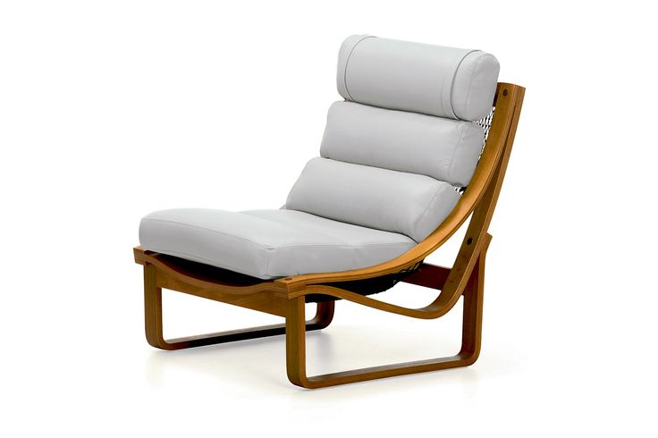 T4 Fixed Chair  This beautiful Australian made Chair, which won Australian design Awards in the 1970′s, is crafted from Teak veneer with solid Timber rails. The Upholstery can be done in any cover of your choice, Fabric or Leather. The cushions are supported by unique Brown Nets which contour to your body shape. It is still made to the same specifications as designed by Fred Lowen in 1973. FIXED CHAIR: W76cm D91cm H88cm FOOTSTOOL: W76cm D76cm H38cm - See more at…