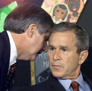 Pres. George Bush being told of the 9/11 attacks while reading to elementary school children in Florida...