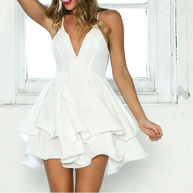 Do you love this White Spaghetti Strap Two-layer Skater Dress? The lower hem like a flower