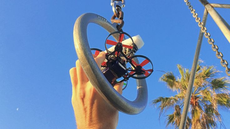 World's smallest HD drone cruises through Muscle Beach.