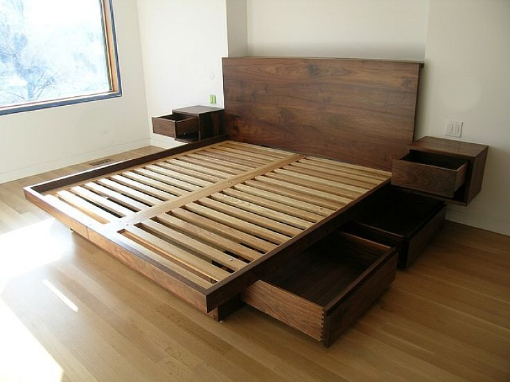 Im not sure how easy this would be to build, but I love the built in nightstand tables on each side. Its still lowish to the ground with storage space underneath. --- Odda Wooden Bed Frame with Drawers