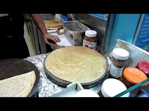 1 minute, 45 seconds to make a Nutella crepe at a sidewalk crepe stand in Paris -- dialogue-free video
