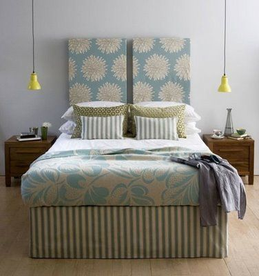 DIY headboard ideas - Cover a couple of canvases in fabric with a staple gun and mount above the bed.