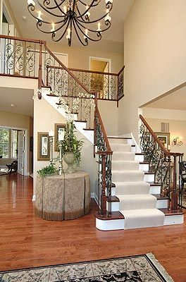 pictures of foyers   The Waterford's dramatic two story foyer and landing staircase with ...