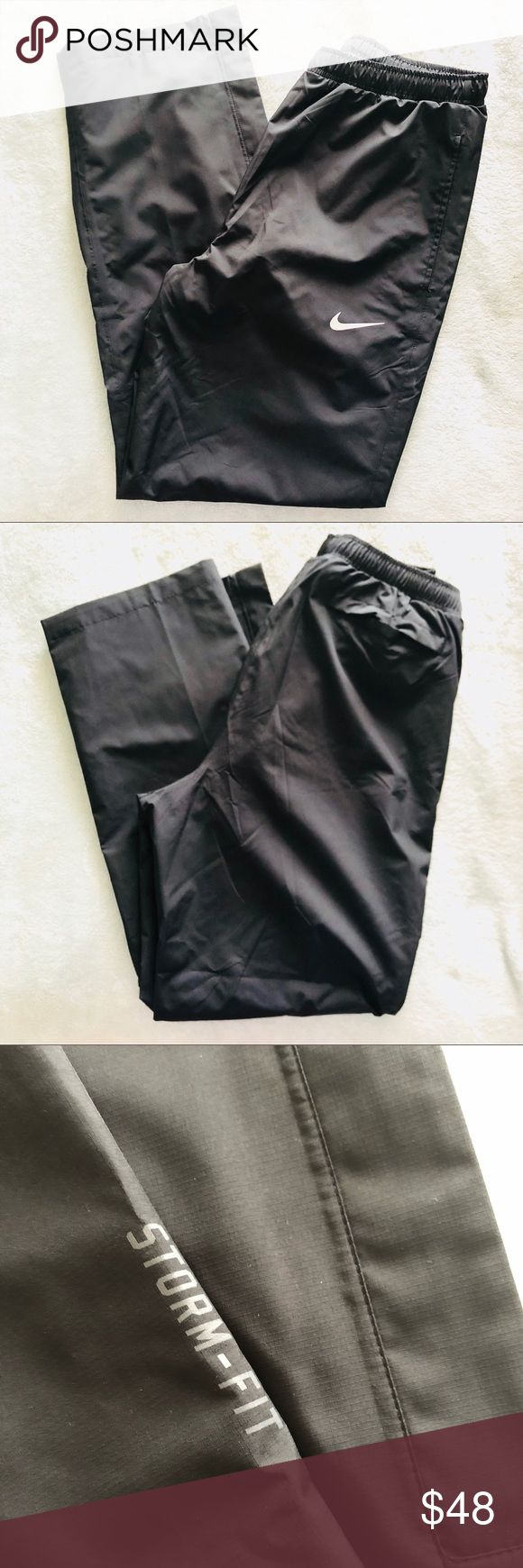 { NIKE } Golf Rain Pants Size Medium. Pants only. Preowned like new condition.  The Nike HyperShield Men's Golf Rain Suit help you stay dry when the weather turns. HyperShield fabric blocks wind and rain to help keep you dry and comfortable. DWR (durable, water-repellent) finish and sealed seams protect from light wind and rain. Zip hems enable easy on and off. Elastic waist on pants with drawcord for a custom fit. Mesh-lined pants for breathable comfort. Fabric: 100% polyester. Machine…