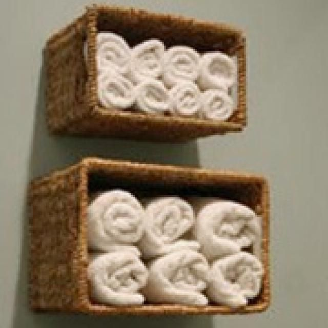 Affordable Bathroom Storage Ideas: Attach Baskets to the Wall - for laundry room too(?)