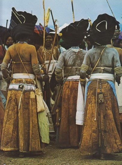 Africa | Thembu (Xhosa speaking) women wore highly decorated leather purses hanging from the hip over leather skirts. | © Alice Mertens - Circa 1960