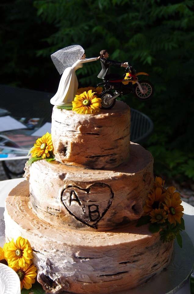 Rustic country wedding cake, tree stump. Dirt bike cake topper