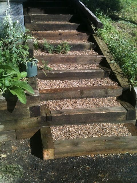 Pea gravel and timber steps. Need something like this to get to lower level of backyard.