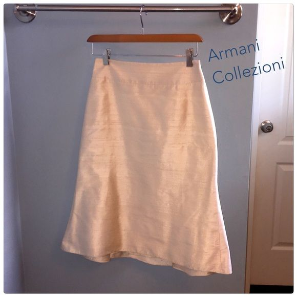 ARMANI COLLEZIONI Rare Trumpet Style Silk Skirt ARMANI COLLEZIONI below the knee rare trumpet style hemline wonderful condition. Size 4. The back zipper has a tiny stretch at the seem line at the bottom of the zipper, but not noticeable.  Great condition 100% raw silk skirt. Lined with 54% viscose and 46% rayon lining. It has a zipper back and single button closure. Included on the tag is an extra button. The approximate measurements are 25 inch length, 26 inch waist and 36 inch waist…