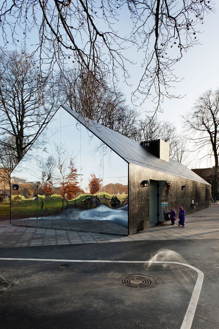 the copenhagen central park in denmark transformed an existing playground pavilion into the 'mirror house',   designed by danish practice MLRP.
