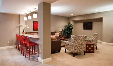 Like the design. Bar/counter area over halfwall with high seating facing the theater room area of a finished basement.