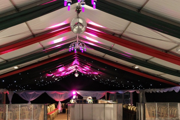 Windsor On Ice (2010), colourful marquee linings and disco lighting with glitter balls, starlight roof  and UV lights.