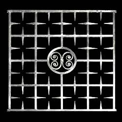 another window grill with celtic center medallion. Less rough but formidable.