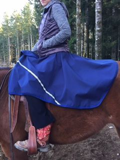Our Riding Skirt shown here in our newest durable, waterproof and wind repellent fabric!! Comes in both regular horse size and now a new Extendable version that fits anything from a pony size all the way up to warmbloods and draft horses! www.discoverytrekking.com/saddle-rain-skirt