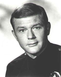 """Actor, Spc3 Martin Milner, US Army (Served 1952-1956) Short Bio: Though a child actor, he is best remembered as Officer Pete Malloy of """"Adam-12"""". Milner was drafted into the Army and sent to work in the Special Services Division at Fort Ord, CA. Over the next two years, he directed 20 military training films."""