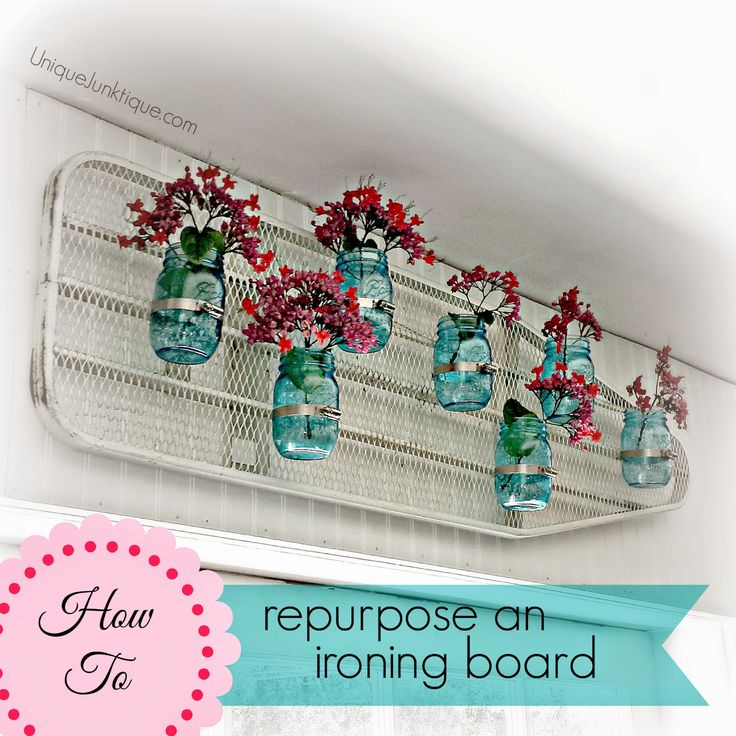 Repurpose an old ironing board into an eye-catching planter hanger!  Cool DIY by Unique Junktique.