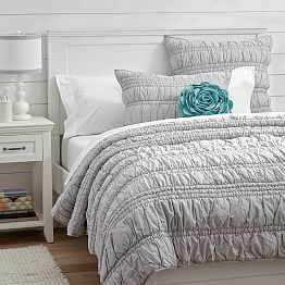 Love this comforter as a backdrop for the bright, floral quilts. It will grow with the girls and the gray will lend a more sophisticated tone.