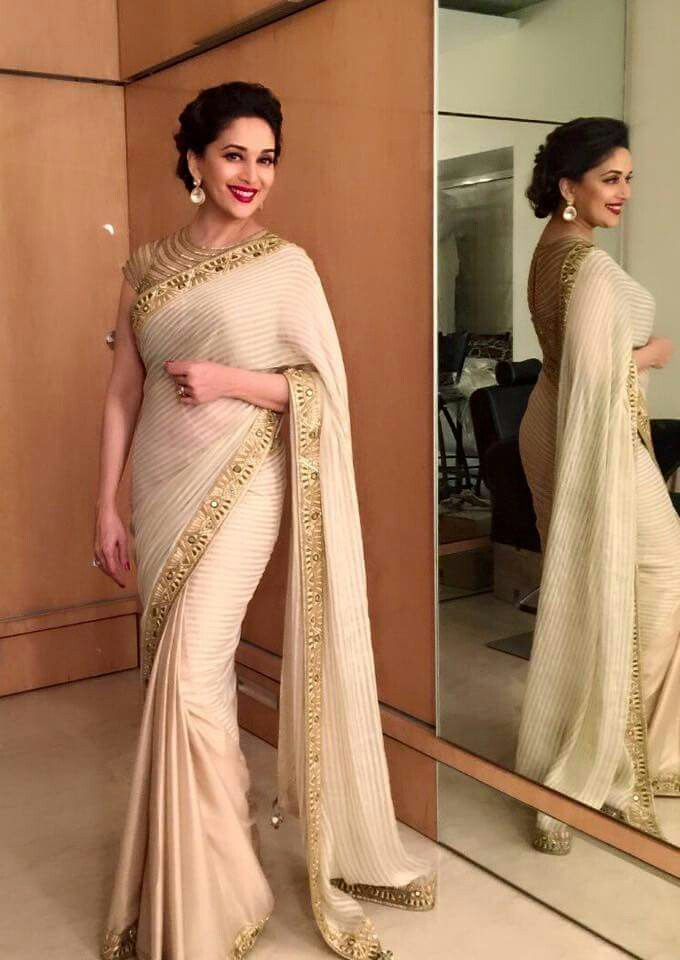 I just love how the saree has been draped on her. Such a classic beauty <3 Madhuri dixit