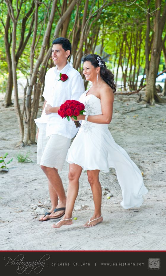 Claudia was given away by her son. I got this shot as they walked to the chuppah through the trees at Foul Bay.  http://www.lesliestjohn.com. http://www.BarbadosDestinationWeddingPhotographer.com  #Barbados #DestinationWedding #Wedding #BeachWedding #Caribbean #Bride