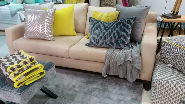 Greys & yellows make a beige sofa pop!