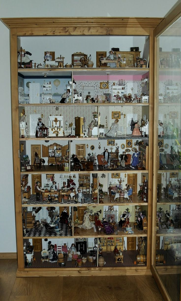 5-6-2014: This is how my dollhouse in the cabinet looks now