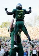 GO DUCKS!! Running back De'Anthony Thomas #6 of the Oregon Ducks celebrates with Nick Cody #61 after Thomas scores on a 64-yard touchdown run in the third quarter at the 98th Rose Bowl Game on January 2, 2012 in Pasadena, California.