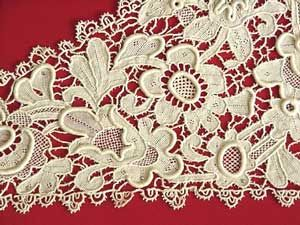 Romanian Point Lace  Lace as a general category can be traced back to its earliest beginnings as knotted nets. Other forms have evolved over time from whitework techniques such as cutwork or drawn work, and from early forms of darn-netting. As more intricate patterns and techniques evolved, owning lace became a status symbol for the wealthy.
