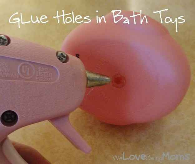 Another use for your glue gun: Plug up those holes in your bath toys so they don't get all moldy.