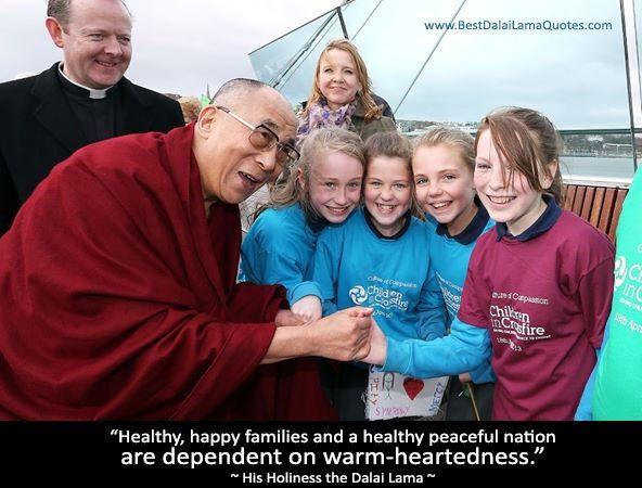 Dalai Lama talking to kids passing by the road