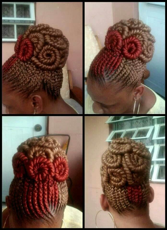 Swirled cornrow updo.  I usually really dislike yarn braids on anybody, but this is really cool, creative, and pretty.