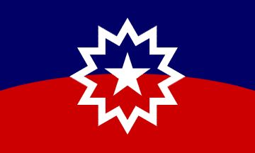 """Juneteenth flag by Lisa Jeanne Graf: """"Juneteenth celebrates when all enslaved in America became free. I created the final design for the Juneteenth Flag. Contributors  were Boston Ben, Verlene Hines, Azim, and Eliot Design. This flag represents the history, & freedom  of American enslaved & descendants. A bursting """"new star"""", on the horizon; represents A NEW FREEDOM, A NEW PEOPLE, A NEW STAR. Red, white, and blue colors communicate that American enslaved, & their descendants are Americans."""""""