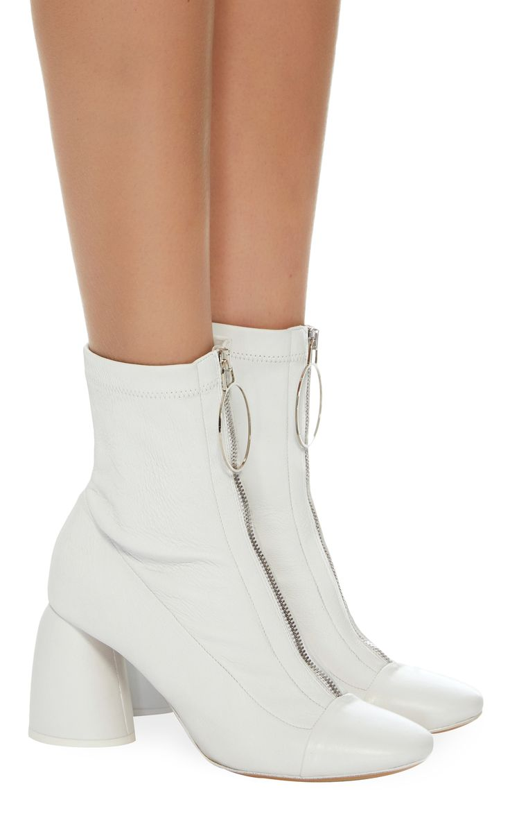 Ellery | Stretch-Leather Ankle Boots - These white boots are set on a spherical block heel and crafted from flexible stretch-leather. Punctuated with a silver zip along the front, this style is designed with an almond toe and has a lightly cushioned insole for comfort. Wear with skirts and dresses. Heel measures approx. 3 inches. Zip fastening along front. Composition: stretch-leather. Made in Italy.