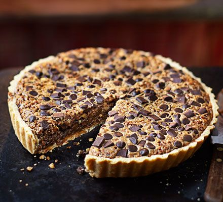 An indulgent chocolate and pecan treat with buttery pastry and a gooey filling everybody can get stuck into