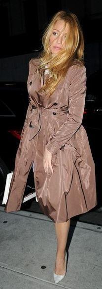 Classy.... Burberry trench coat, Christian Louboutin white snake skin pumps, Chanel handbag.