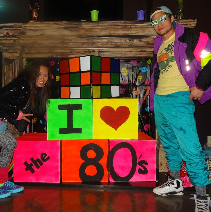 80s theme party decor: rubix cube acrylic paint,  thin black duct tape,  and a cardboard box.  Other boxes,  latex primer, neon spay paint and acrylic paint for letters