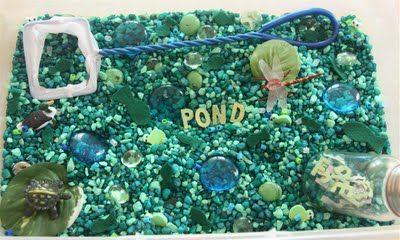 """Pond"" Sensory Tub - blue & green aquarium rocks & glass beads, fish net, plastic animals or erasers, silk plants"