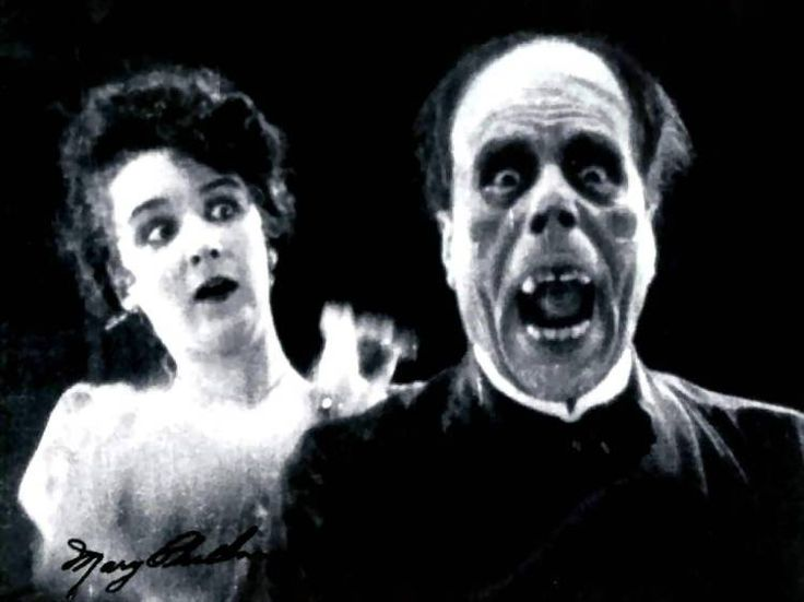 Even actress Mary Philbin was actually surprised when ERIK The Phantom's mask was removed because actor LON CHANEY kept it a secret until this very moment. If you go back and look at this scene the Cameraman is even shaken as the deformed Phantom approaches him. Because like Mary that was his first glimpse of ERIK as well. Lon Chaney did all his own Make-UP and this was his most famous. I know he rigged devices in his nose and mouth to get the grotesque living skull look. His Nostrils Flared…