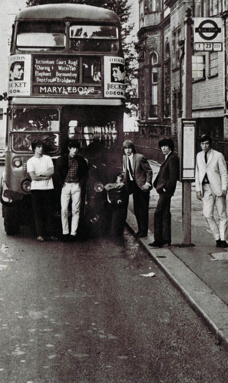 Fantastic black and white shot of The Rolling Stones posing with a London bus in the mid 1960s    Left to right Mick Jagger, Keith Richards, Brian Jones, Bill Wyman and Charlie Watts