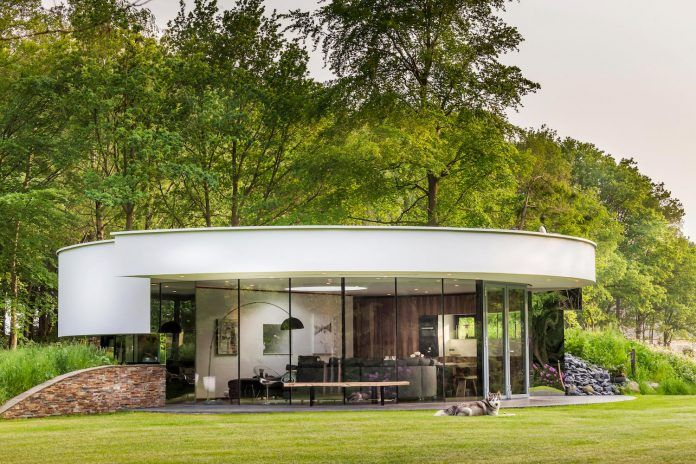 Tiny modern circular villa in a Dutch forest by 123DV - CAANdesign | Architecture and home design blog