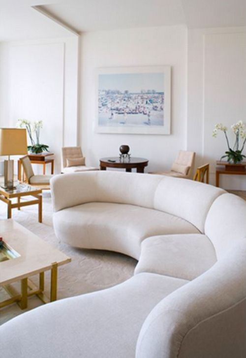 Create a scene in the living room with a furniture piece that becomes an instant focal point. If you've got the space, one of these 20 round couches will s