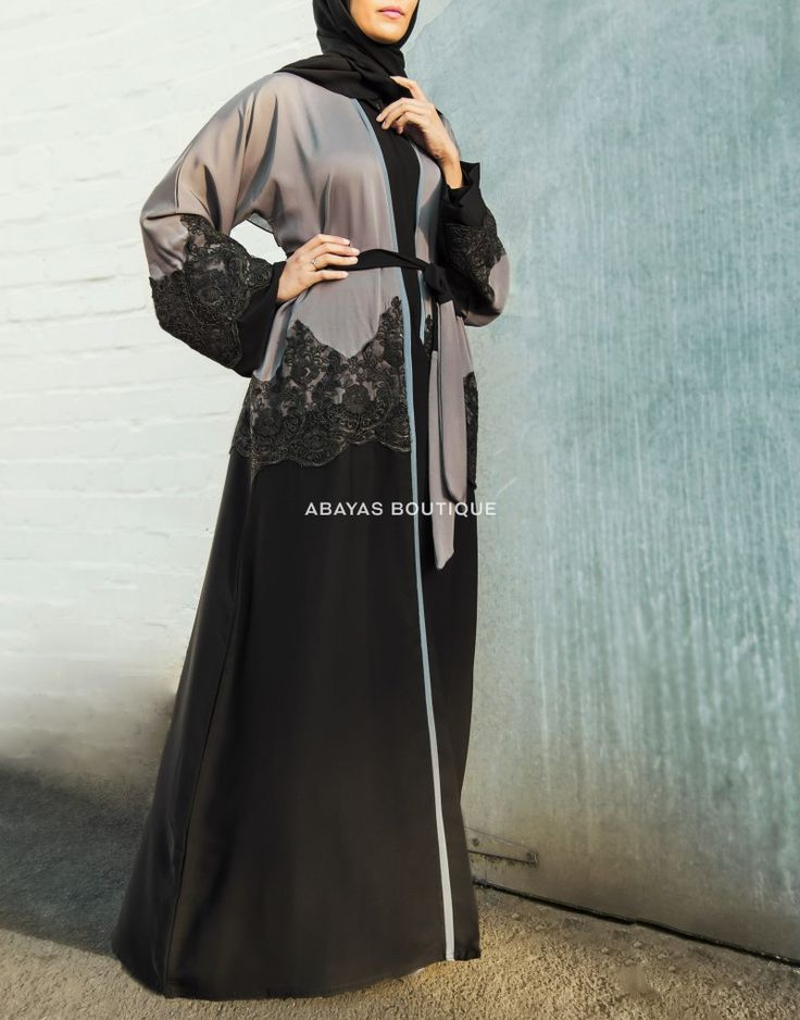 Charming contrast of grey and black with a lace overlay alongside pastel, blue chiffon trim on this striking abaya.