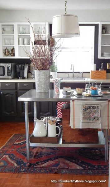 Love this house tour of Number Fifty Three and the gorgeous kitchen - mismatched cabinets, open shelving and stainless island!  eclecticallyvintage.com